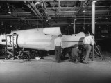 Assembling at Factory  Showing Two Halves of Fuselage Being Fitted Together  Curtiss-Wright Plant