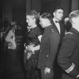 Mrs Clarice Inness Holding Hands with Chinese Air Force Lieutenant David Shuh at UN Party