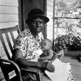 Mrs Albert Thornton Sitting on Porch Holding Her Sleeping Infant Great-Grandchild