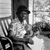 Mrs Albert Thornton Sitting on Porch Holding Her Sleeping Infant Great-Grandchild