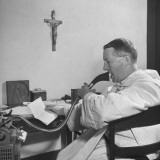 Monk Speaking into a Dictaphone at an Episcopal Monastery