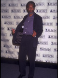 Actor Morgan Freeman Standing and Holding Jacket Open at Vh1 Honors
