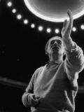 Conductor Herbert Von Karajan Raising Hand During Rehearsals in Unidentified Music Hall