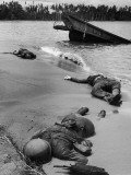Bodies of Dead American Soldiers Near Half Sunken Landing Craft on Buna Beach