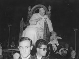 Pope Pius XII Putting Hand on Baby's Head to Bless it as He Is Being Carried in Papal Chair