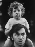 Bill Graham Carrying His Young Son David on His Shoulders Outside Home