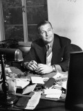Movie Producer Mark Hellinger Sitting at His Desk at Warner Bros Studios