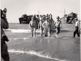 Generals MacArthur and Sutherland and Colonel Lehrbas Wading Ashore at Lingayen Gulf