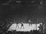 Joe Louis and Joe Walcott Boxing in Front of a Wide Eyed Crowd