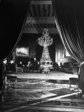 Jockey Club's Salon Room with Velvet Drapes and Crystal Chandeliers