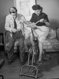 Producer-Director Preston Sturges and His Secretary Trying Out an Exercise Bicycle