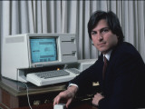 Apple Computer Chrmn Steve Jobs with New Lisa Computer During Press Preview