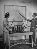 The Duke of Windsor Showing His Wife an Island on the Map