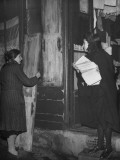 Salvation Army Worker Holding Papers and Talking to Woman