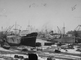 A View of Ships Lying in the Repair Docks of a Shipyard