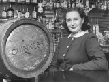 Irish Barmaid at Airport Bar with Keg of Guinness Beer