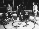 A View of People Playing a New Game Called Curling