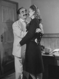 Comedian Groucho Marx Embracing a Woman