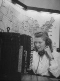 Woman Talking on Telephone in FBI Office