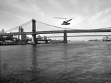 NYC Police Helicopter Hovering over the East River Next to the Manhattan Bridge