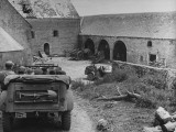 Jeeps Carry Members of US High Command Passing Through Courtyard Where Fighting Took Place