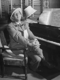 Comedian Phil Silvers Sitting by His Piano