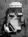 Farmer Removing Seats of His Jeep in Demonstration of Postwar Uses for Military Vehicles