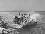 Soldier Driving Sea-Going Jeep into Water