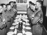 Marines Standing at Attention  before Eating  in the Mess Hall