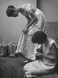 Eileen Ford Repairing a Gown So Model Barbara Mullen Can Wear it to a Party