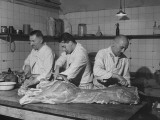 Three Butchers Chopping Up Meat for Supper in Kitchen of the Polonia