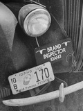 1949 Idaho License Plate Featuring a Buttered Baked Potato on a Cattle Brand Inspector's Car