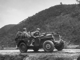 American Soldiers Riding in a Jeep