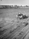 Farmer Using His Jeep to Pull a Rotary Hoe in Demonstration of Postwar Uses for Military Vehicles