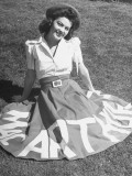 "A Woman Wearing a Skirt That Says ""Macarthur"" in Honor of General Douglas Macarthur"
