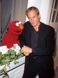 Singer Michael Bolton with &quot;Sesame Street&quot; Television Series Puppet Elmo at Sesame