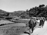 US Marines March Towards the Front Lines During the Fight to Take the Island of Okinawa