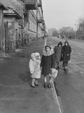 Children Wearing Heavy Coats During the Spring Fashion