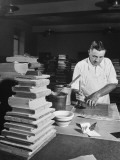 A Man Covering Book Signitures and Sewing with Glue and Binder Paper at the Congressional Library
