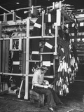 Workman at General Electric Transformer Plant Building a 3-Phase Transformer