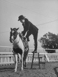 Actress Buff Cobb  Getting Off of Her Horse