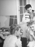 Dancer Theodora Roosevelt Applying Her Make-Up While Alexander Iolas Gets Dressed