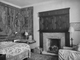 Cranborne Manor Bedroom  with an Old-Fashioned Coverlet  a Fireplace  and Tapestry Hanging