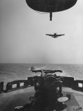 Fighter Plane Coming in for a Landing onto Flight Deck of a US Navy Carrier