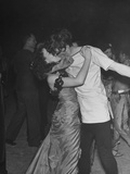 A Couple at the Chelsea Arts Ball Kissing While They Dance