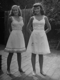 Two Girls Modeling Sun Dresses Designed by a Very Young Fashion Designer