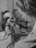 Artist at Madame Tussaud&#39;s Waxworks Inserting Hair in Sculpture of Gen Douglas A Macarthur