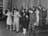 Wounded Soldiers and Women Practicing and Learning a Series of Dance Steps at Walter Reed Hospital