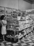 Interior View of Modern Grocery Store  Displaying Canned Goods  Cereals and Soap