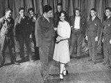 A Woman Teaching Wounded Soldiers a Series of Dance Steps at the Walter Reed Hospital